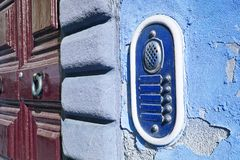 Old colored bell system on blue plaster Stock Photo