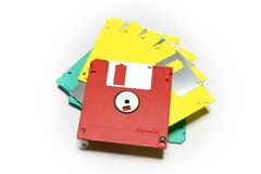Old colored computer floppy disks  on white background. Royalty Free Stock Photos