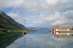 Old colored houses and boat in Mosjoen, Norway Royalty Free Stock Image