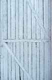 Old, colored paint, cracked wooden door with diagonal slats Stock Images