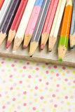 Old colored pencils on table cloth Royalty Free Stock Images