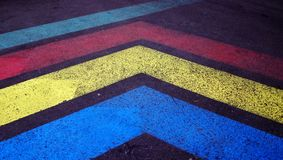 Old colored road markings. strips on old asphalt stock photography