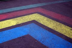 Old colored road markings. strips on old asphalt royalty free stock photography