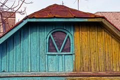 Old colored wooden loft with a small window Royalty Free Stock Photos