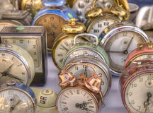 Old colorful antique alarm clocks. Stock Images