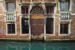 Apartments on a canal, Venice, Italy Stock Photo