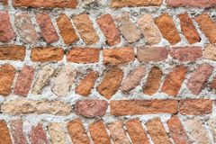 Old colorful brick wall texture background. Wall background for designers. Vertical and horizontal brick placement. Stock Photography