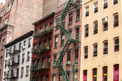 Old colorful buildings with fire escape,NYC, USA Stock Images