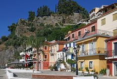 Old colorful buildings and fort on hill Parga Royalty Free Stock Image
