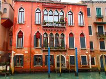 Buildings in Italy. Old colorful buildings in Venice, Italy with superb architecture on Grand Canal prepared for Venetian masks carnival Royalty Free Stock Photo