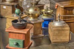 Old colorful coffee grinders. Stock Photo