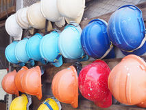 Old colorful construction helmets Stock Image