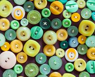 Old , colorful and different shapes buttons, sewn to the pillow. top view, flat lay. royalty free stock photos