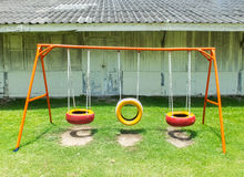Old Colorful Empty Chain Swings made from Vehicle Wheels on Kids Playground in Thailand Royalty Free Stock Image