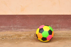 Old colorful football on cement floor. Old colorful football on grunge cement floor Stock Photo
