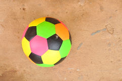 Old colorful football on cement floor. Old colorful football on grunge cement floor Stock Photos