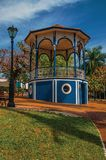 Old colorful gazebo and lighting pole in the middle of verdant garden, in a sunny day at São Manuel. stock image