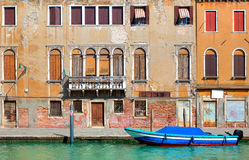 Old colorful house along narrow canal in Venice. Royalty Free Stock Photos