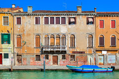 Old colorful house along narrow canal in Venice. Stock Photos