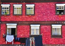 Old colorful house with tiled walls Royalty Free Stock Images