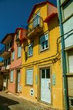 Old colorful houses on alley stock photography