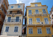 Old houses on Corfu islan. Old colorful houses with balcony in downtown of Corfu island Royalty Free Stock Photo