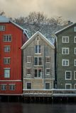 Old, colorful houses and magazines by Nidelva river in Trondheim, Norway. royalty free stock photo