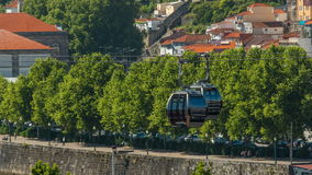 Old colorful houses in old part of Porto and cable car over  Douro river timelapse stock video