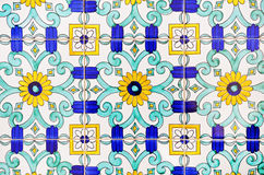 Old and colorful italian painted tiles with intere Royalty Free Stock Image