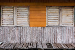 Old colorful moldy wood wall and musty wood window, break and be Stock Images