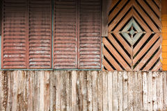 Old colorful moldy wood wall and musty wood window, break and be Stock Image