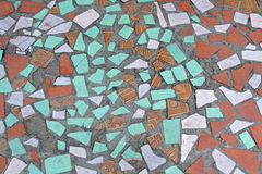 Old colorful mosaic on the floor of broken ceramic tiles Royalty Free Stock Images