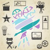 Old colorful movie camera. With movie icons on retro grunge background Royalty Free Stock Photos