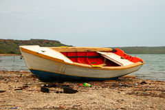 old colorful painted boat on a beach Stock Photography