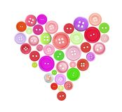 Old colorful plastic buttons in heart shape isolated on white Stock Photos