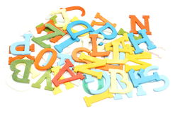 Old, colorful, plastic letters on white background Royalty Free Stock Image