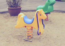 Old colorful seesaw Stock Image