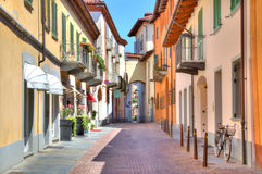 Old colorful street in Alba, Northern Italy. Stock Photography