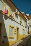 Old colorful terraced house with clothes hanging on window. Drying on sunny day, in an alley of Portalegre. A nice little town at the bottom of Mamede Mountain royalty free stock images