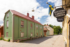 Old Colorful timber buildings. Vadstena. Sweden. Old Colorful timber buildings. Gottfrid Larsson museum (Gottfrid Larsson Garden) and Lace museum (Spetsmuseum) Royalty Free Stock Images