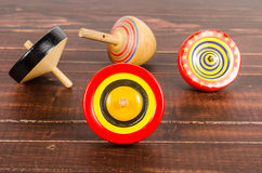 Old colorful wooden spinning top toy Stock Photos