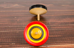 Old colorful wooden spinning top toy Royalty Free Stock Images