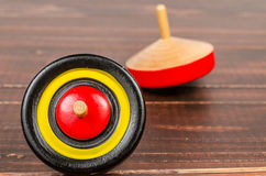 Old colorful wooden spinning top toy Stock Photography