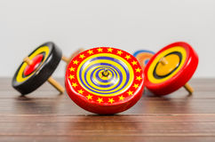 Old colorful wooden spinning top toy Stock Image