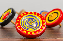 Old colorful wooden spinning top toy Stock Images