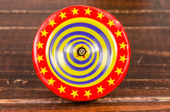 Old colorful wooden spinning top toy Royalty Free Stock Photo