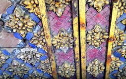 Old colour glass decoration on temple wooden  door Stock Photos