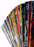 Old Coloured Comics. Old colored comics piled on white background (detail stock image