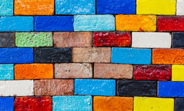 Old colourful brick, wall texture background. Royalty Free Stock Photo