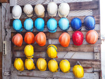 Old colrful construction helmets Stock Images